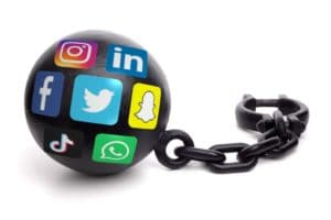 Ball and chain with social media logos isolated on a white background